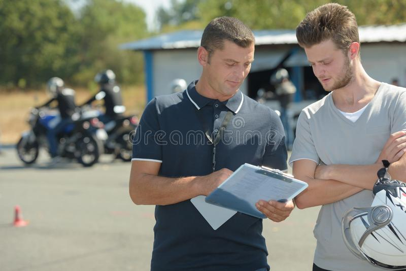 Motorcyclist has driving test in moto school for drivers license. Motorbike stock images