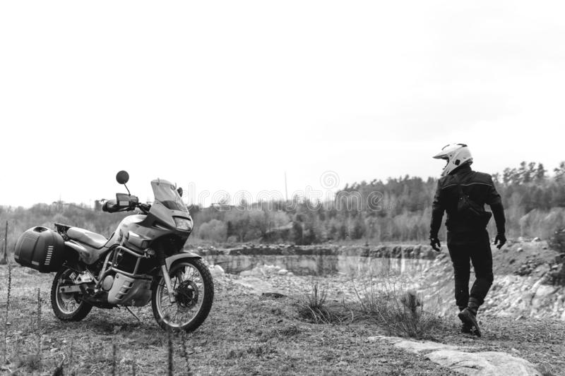 Motorcyclist man with Adventure Motorbike. Off road. Motorcycle trip. enduro Traveling, Lifestyle Travel dual sport outdoor. Concept. clothing with protection royalty free stock photo