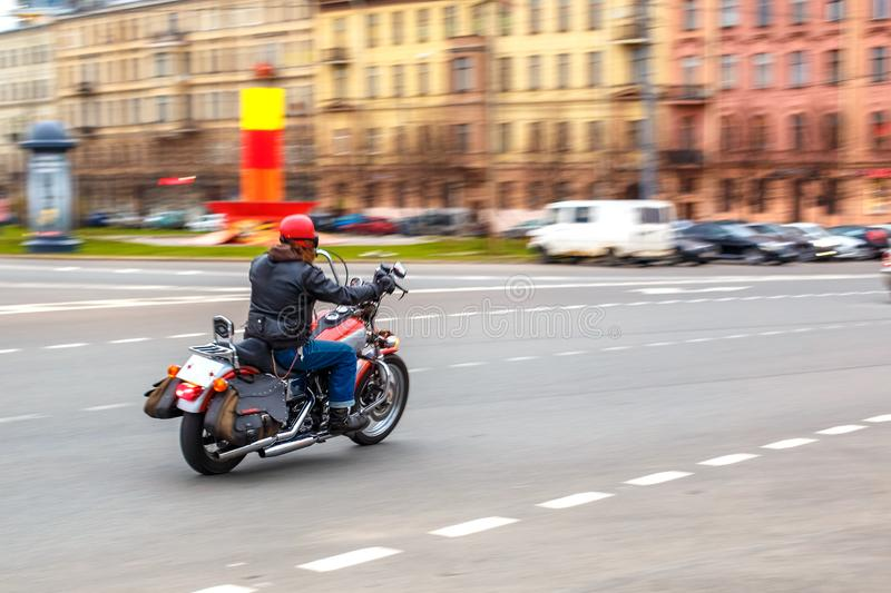 Motorcyclist rides at speed on city roads, may 2018, St. Petersburg stock photos