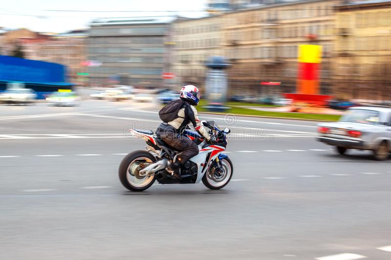 Motorcyclist rides at speed on city roads, may 2018, St. Petersburg stock photo