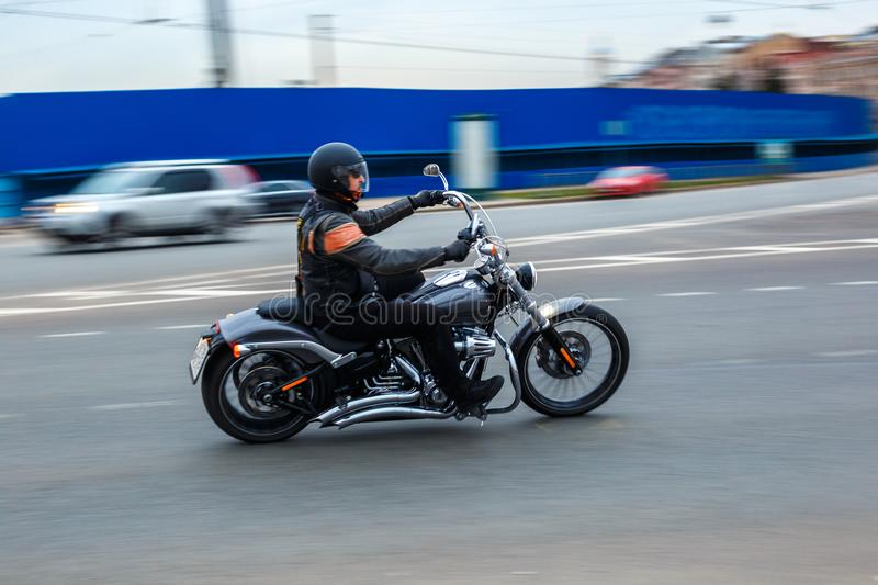 Motorcyclist rides at speed on city roads, may 2018, St. Petersburg stock images