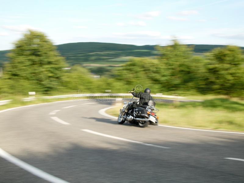 Motorcyclist, taken with motion blur 4 royalty free stock images