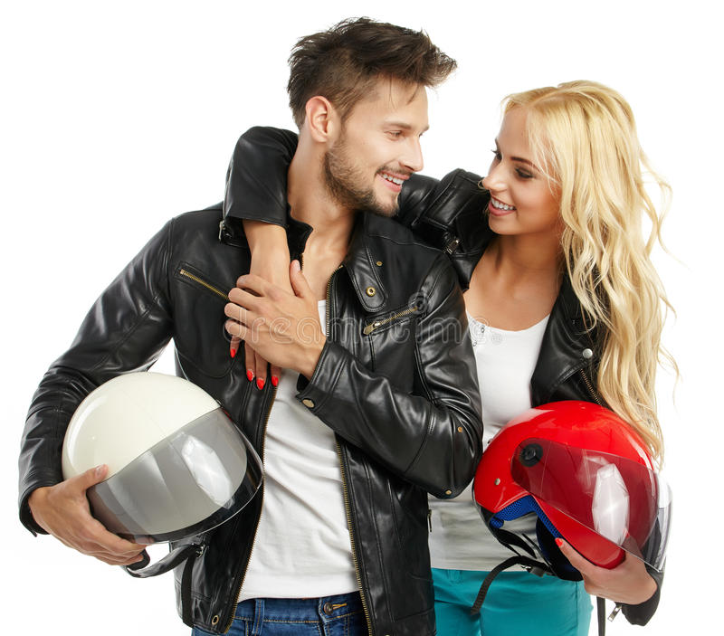 Motorcyclists couple with helmets stock image