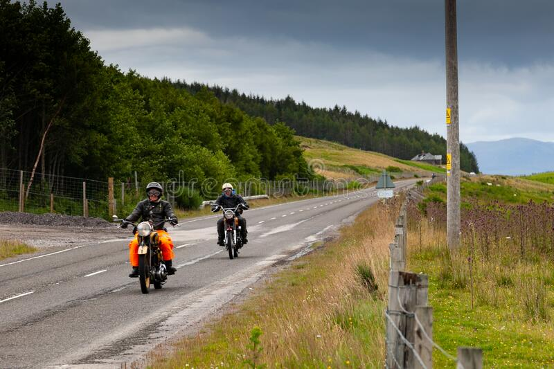 Motorcyclists touring on vintage motorbikes  royalty free stock photos