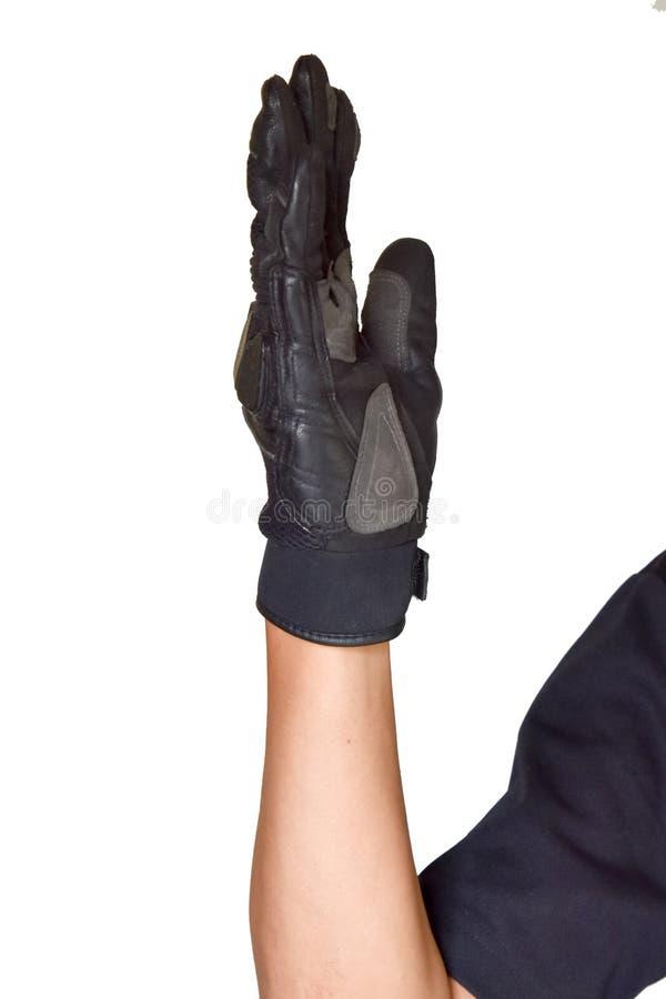 Motorcykelhandsken och handsignalen går framåt royaltyfri foto