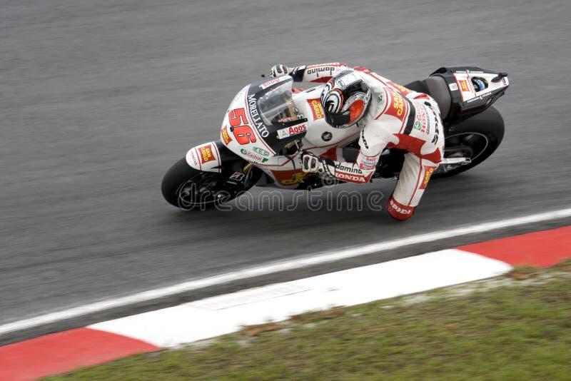 Motorcykelracer i uppgift royaltyfria foton