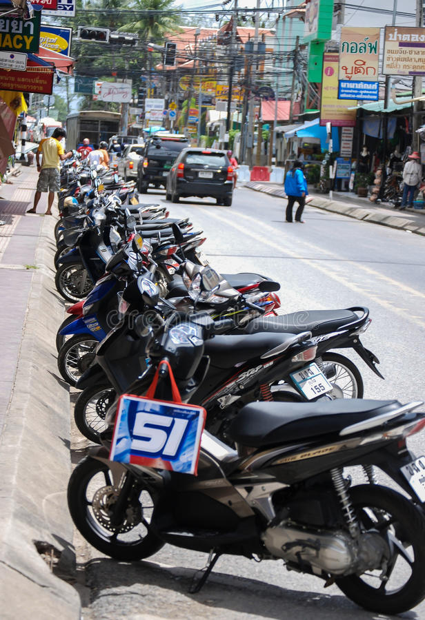 Motorcyles in Phuket, Thailand. A scene in downtown Phuket, Thailand. Motorcycles are a popular mode of transportation in this area. Photo Taken June 23, 2009 royalty free stock images