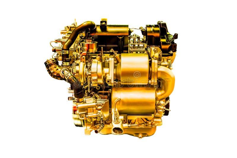 Motore di automobile dorato potente moderno isolato su bianco fotografia stock