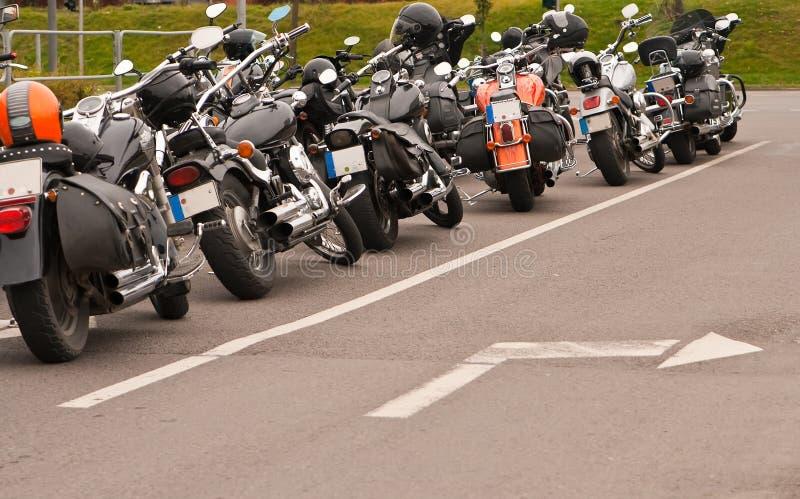 Motorfietsen en Pijl stock afbeeldingen