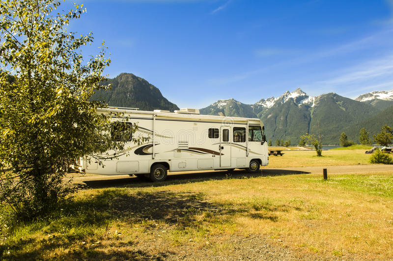 Motorhome in Canada. Motorhome side view in front of mountains in Canada royalty free stock image