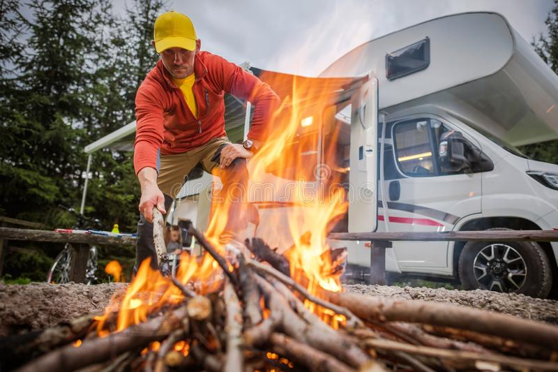 Motorhome Spot and Campfire stock image
