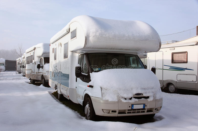 Motorhome at winter. Motorhome and caravan at winter with snow stock photography