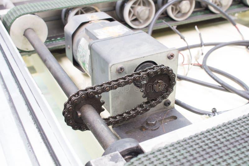 Motorisk drevaxel och överföringskedja, transportör royaltyfria bilder