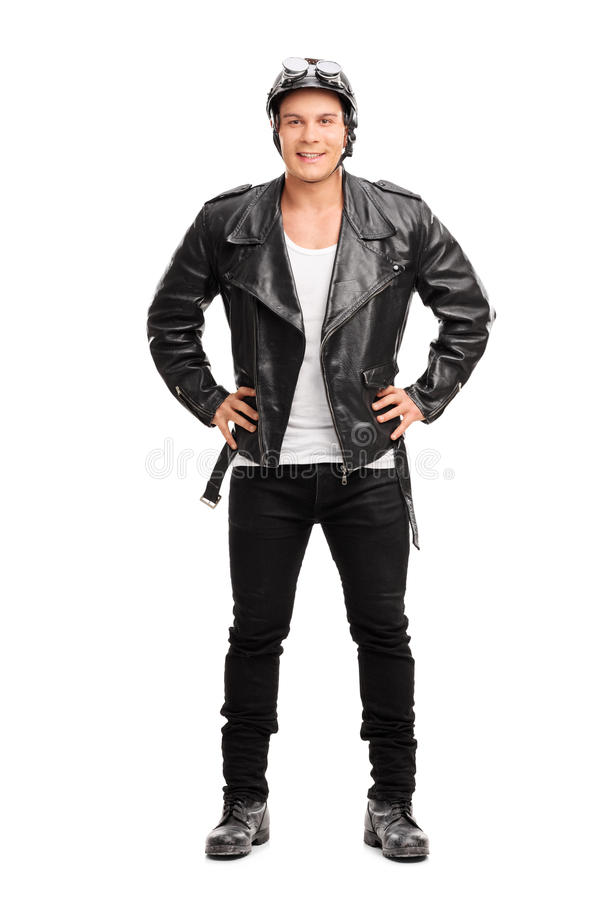 Motorista alegre joven en una chaqueta de cuero negra imagenes de archivo
