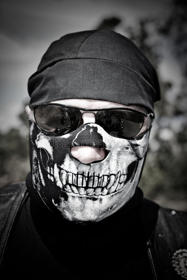 Motorista con la máscara foto de archivo