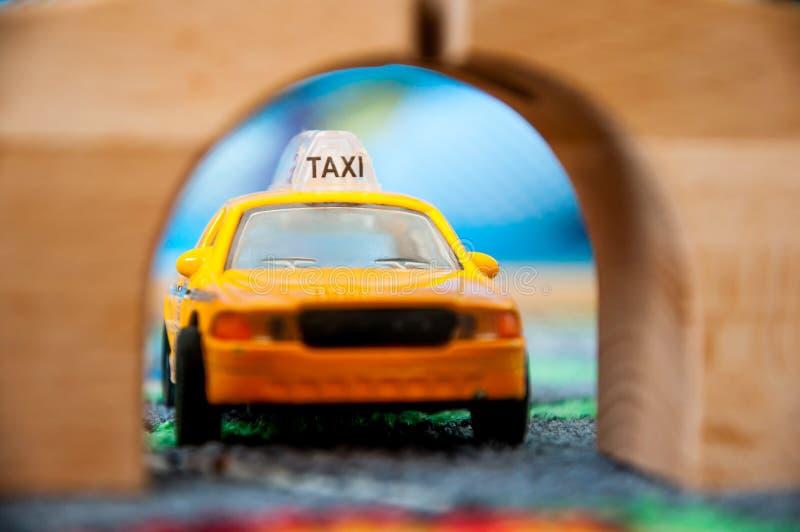 Motorista de Texi, carro do brinquedo imagem de stock royalty free
