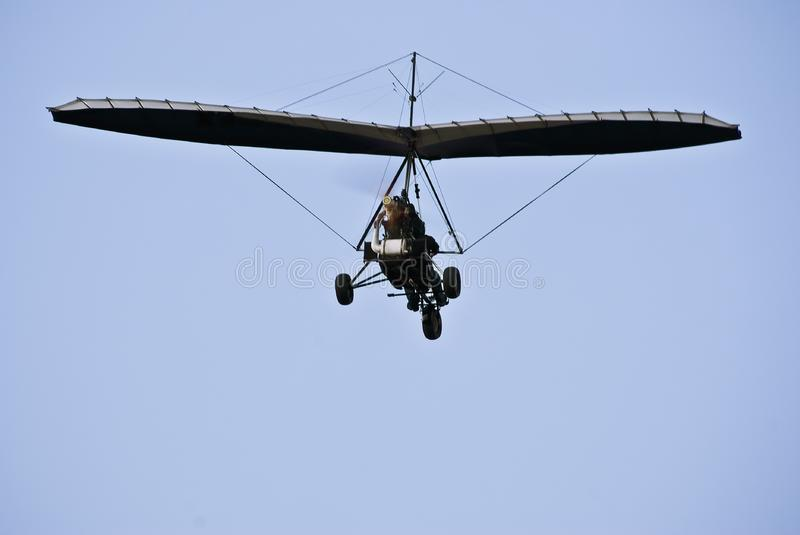 Motorized Hang Glider in Flight - Rear View stock photography