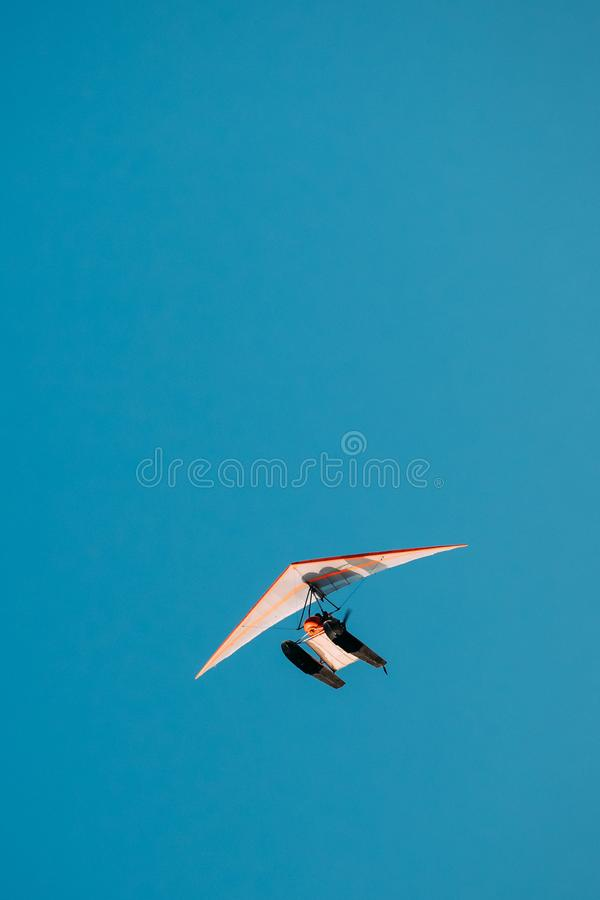 Motorized Hang Glider Flying On Blue Clear Sunny Sky Background stock images