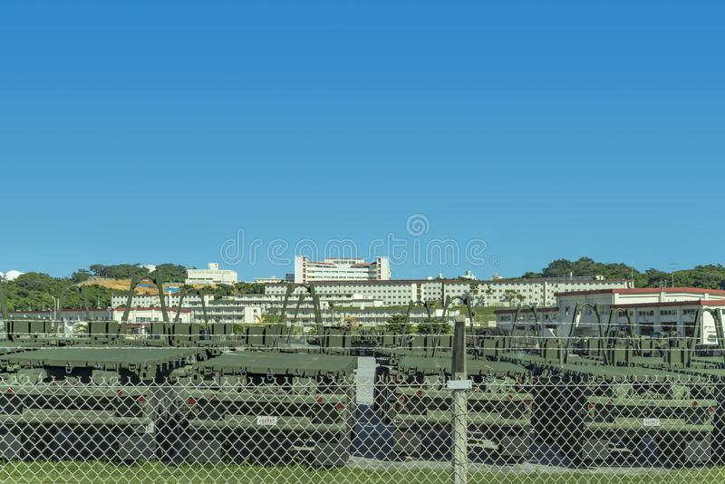 Motorized vehicles lined up at a US military base on the island of Okinawa stock images