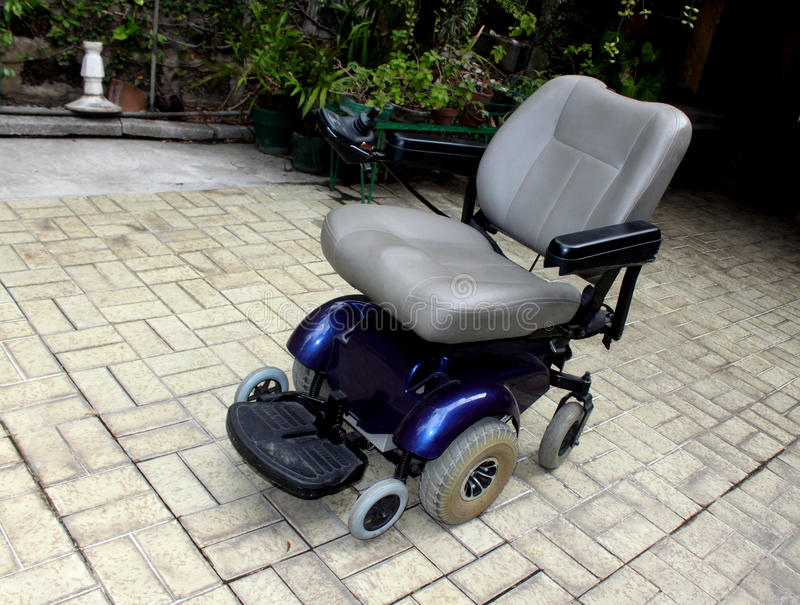 Motorized Wheel Chair. Specially manufactured for handicapped persons stock images