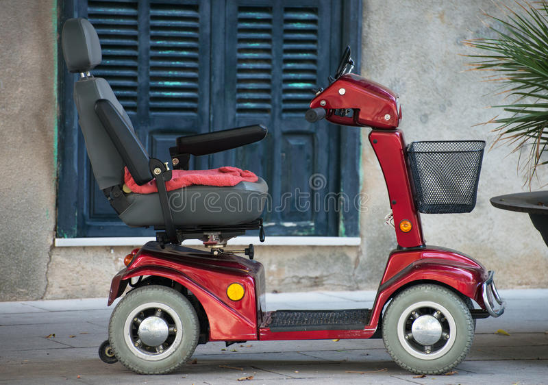 Motorized wheelchair car. Motorized wheelchair car for disabled people royalty free stock photo