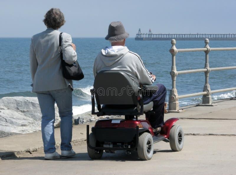 Motorized wheelchair user royalty free stock photos