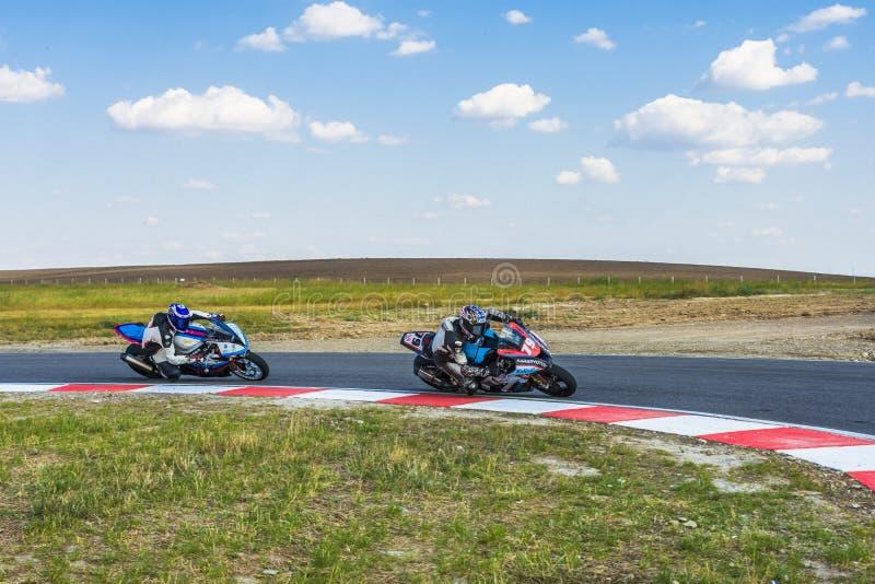 Motorrijder het Rennen stock afbeelding