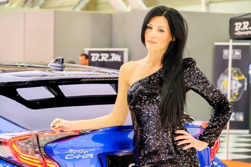 Motorshow girl black hair elegant sequin glitter dress stock image