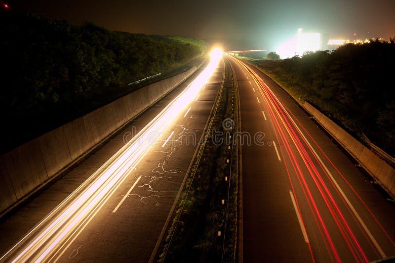 Motorväg på natten royaltyfria foton