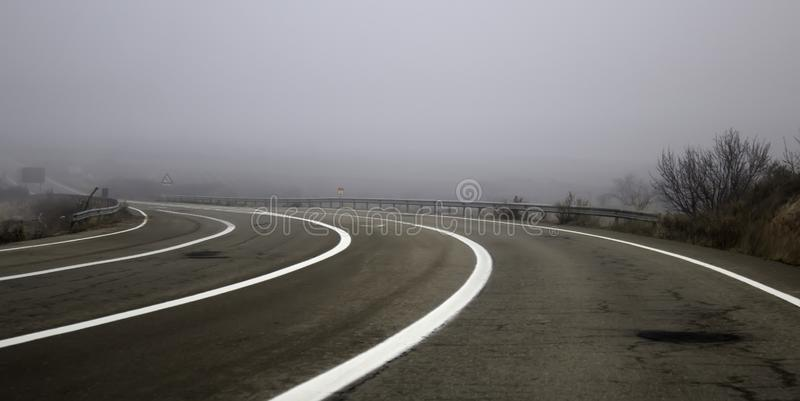 Motorway highway with fog. Highway highway with fog, traffic and vehicles, travel stock images