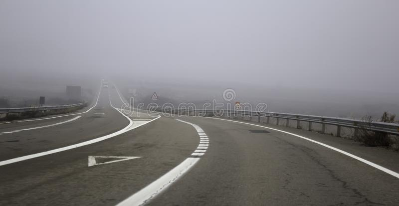 Motorway highway with fog. Highway highway with fog, traffic and vehicles, travel stock photos