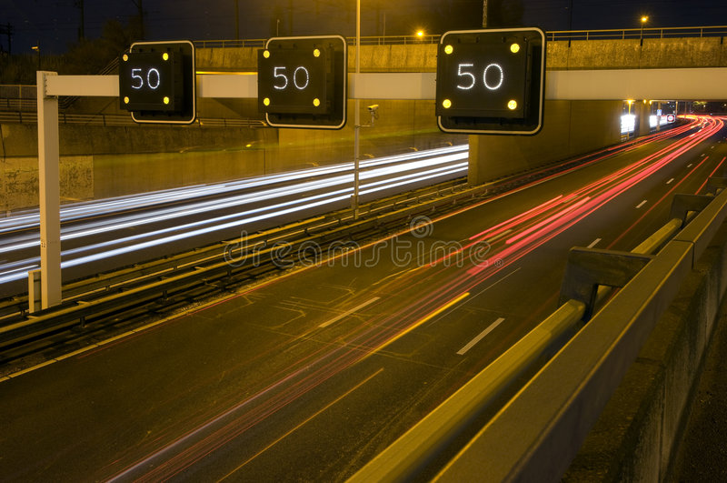 Motorway Information System. Indicating a speed limit and traffic jam ahead royalty free stock photo