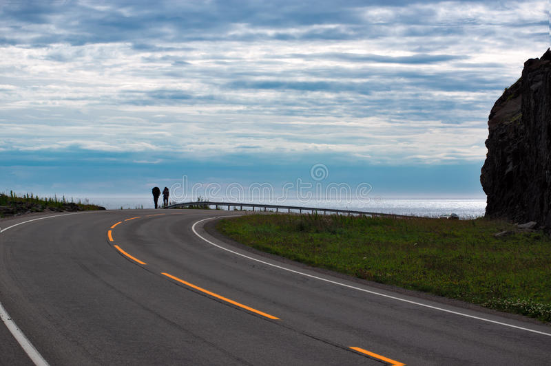 Motorway leading from Reine to A with two tourist. In Norway, Lofoten royalty free stock images
