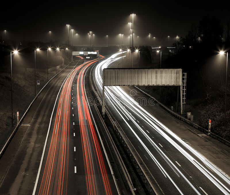 Motorway M80 in the mist. Car light trails at night on the M80 motorway near Glasgow in the mist stock images