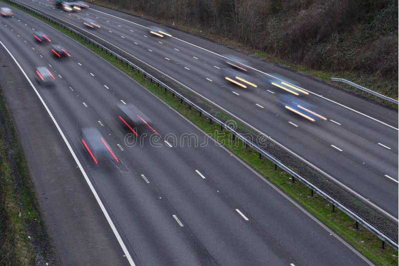 Motorway med trafik royaltyfria bilder
