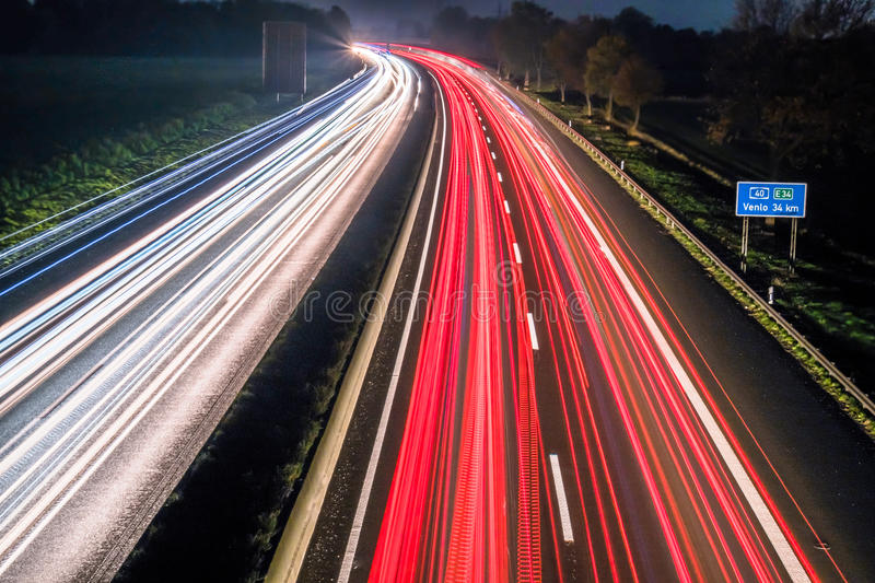 Download Motorway At Night With Fast Moving Cars Stock Image - Image: 83709065
