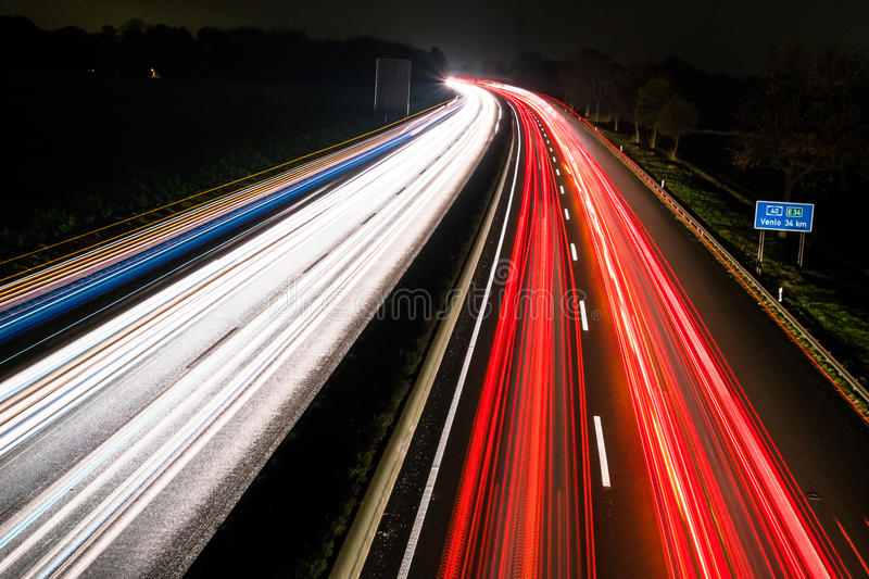 Download Motorway At Night With Fast Moving Cars Stock Image - Image of line, light: 83709431