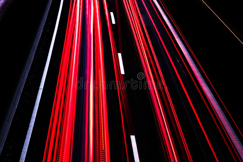 Download Motorway At Night With Fast Moving Cars Stock Photo - Image: 83710278