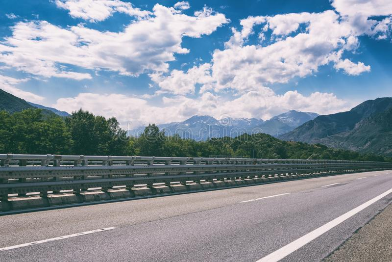 Motorway road in Alps, beautiful day time landscape with blue cloudy sky stock photos