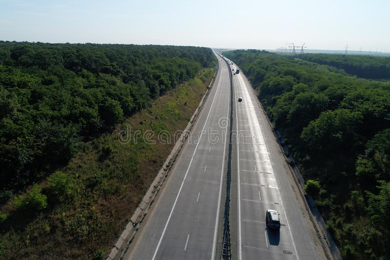 Motorway seen from above, green forest on both sides royalty free stock photo