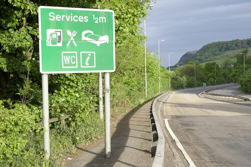 Motorway services sign countryside rural area WC toilets fuel petrol mall shops rest break time for tired drivers royalty free stock photo