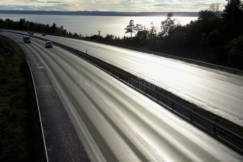 Motorway in sunset royalty free stock photography