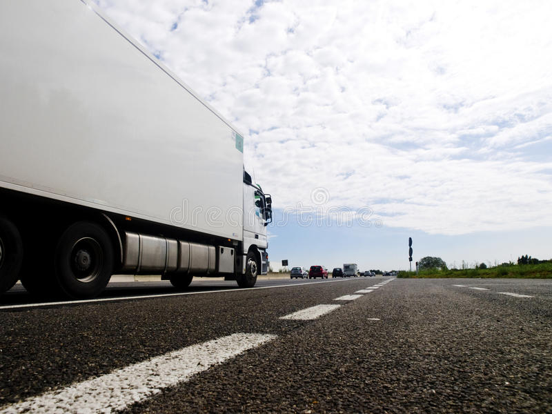 Motorway traffic scenery. Motorway scenery with truck and road marks stock photos