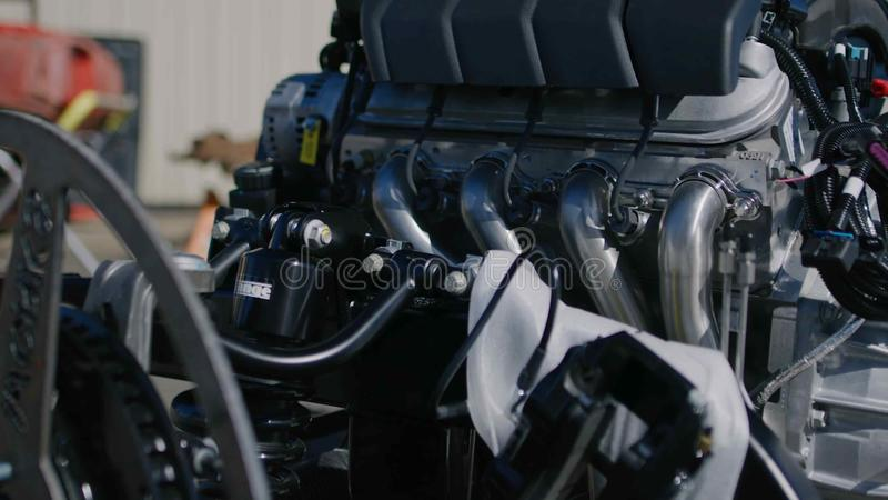 Motot sporty machine close-up. Motor assembly of a sports car in black closeup stock photo