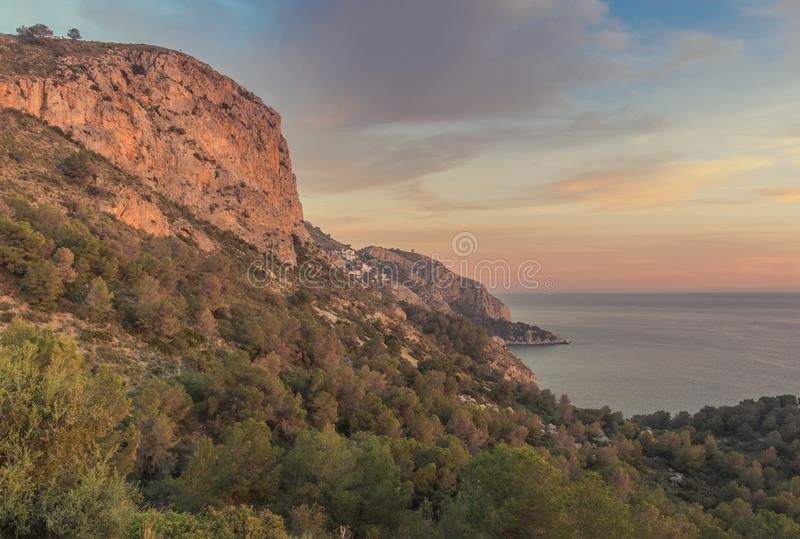 Cliffs of the coast of Motril. Motril, Granada, Andalusi, Spain - February 10, 2019: Sunset on the cliffs of the coast of the village Motril stock image