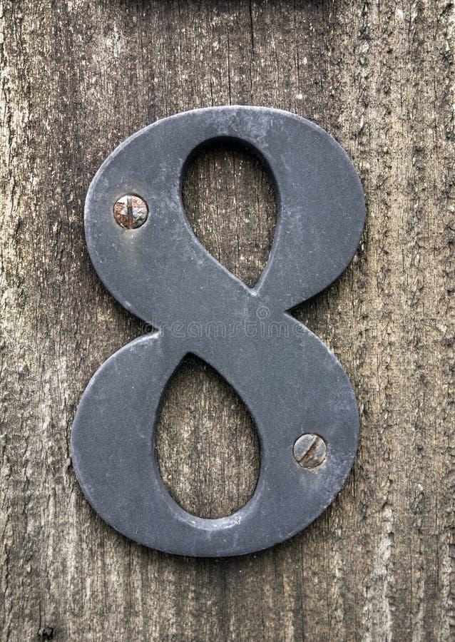 Mots écrits dans l'état affligé numéro trouvé par typographie huit 8 photographie stock libre de droits