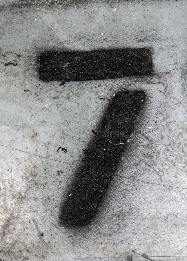 Mots écrits dans l'état affligé numéro trouvé par typographie sept 7 image stock