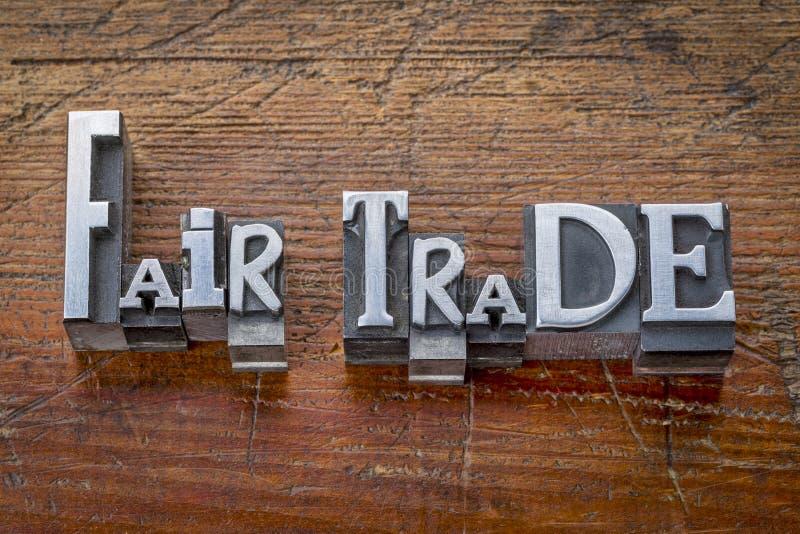 Mots de commerce équitable dans le type en métal images libres de droits