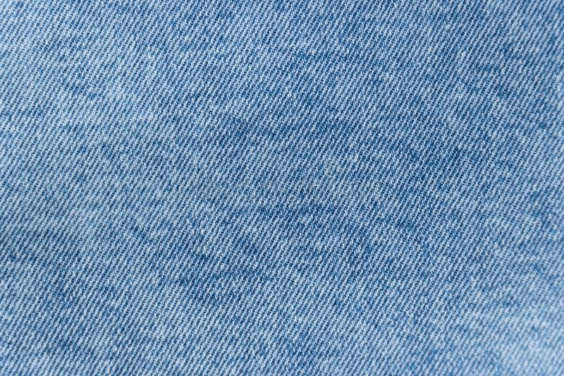 Mottled fabric denim style fine stuff soft material light blue. Mottled fabric denim style fine stuff soft material stock photos