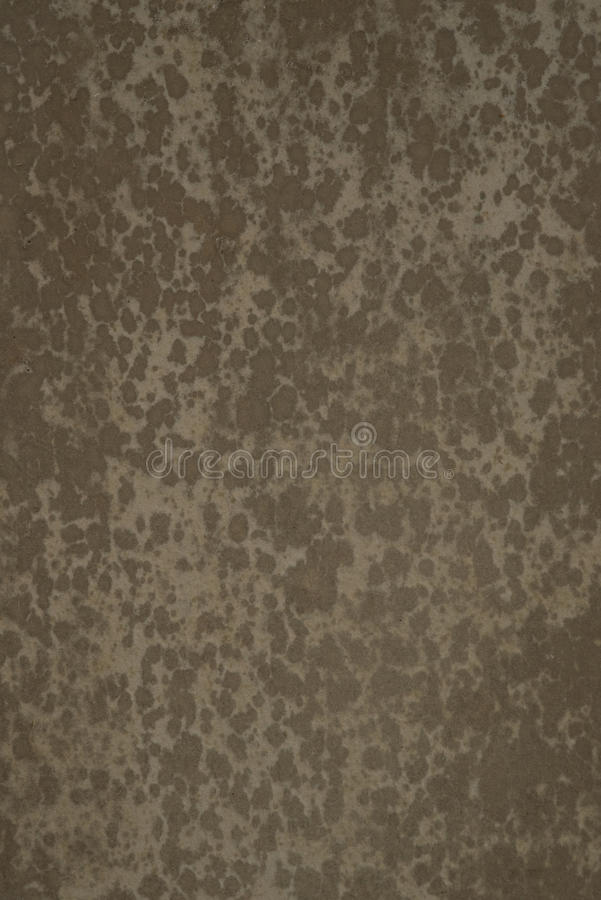 Mottled paper. Vertical format, mottled paper for compositing / comping, overlay texture or background. Low contrast and low key image royalty free stock images